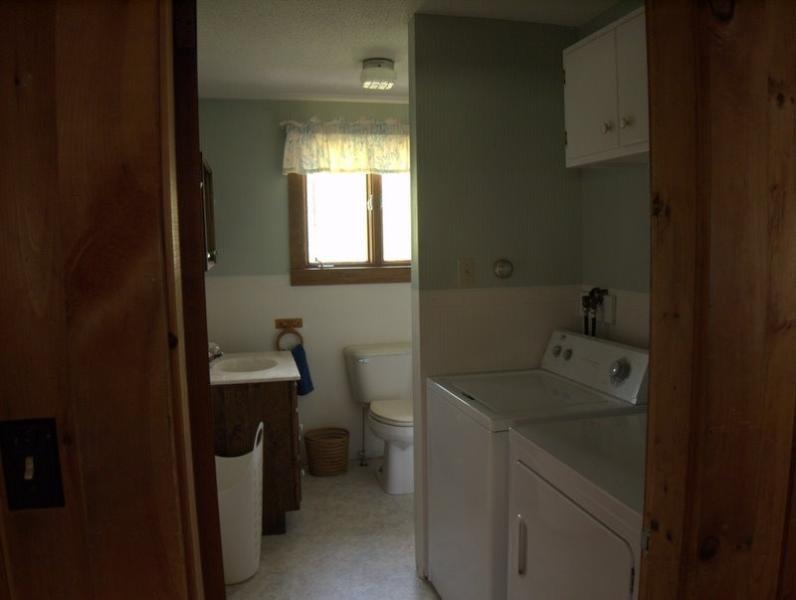 Upstairs Bath, Shower ( around the corner ) and  Laundry