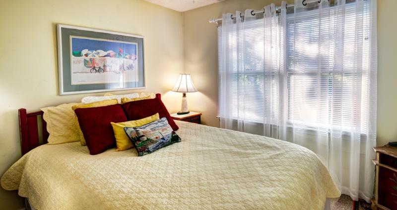 Bedroom 2, with queen pillowtop mattress, ceiling fan, and flat screen TV/DVD