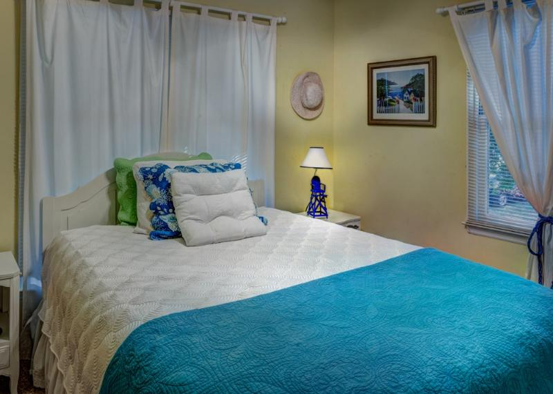 Bedroom 3 with queen-size bed, ceiling fan, and flat screen TV/DVD