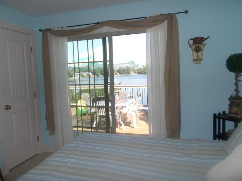 Master Bedroom With Walk Out to Deck Overlooking Lake.