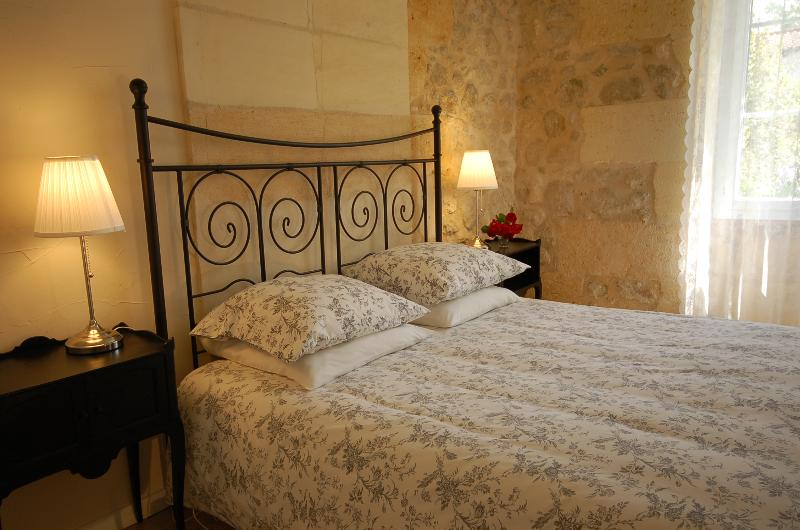 The ground floor room has a King size bed and two large windows overlooking the gardens.