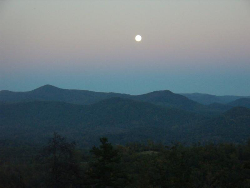 View of moon over mountain  from cabin deck
