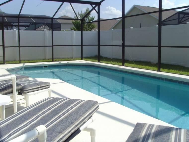 Plenty of padded sun beds in full privacy pool area