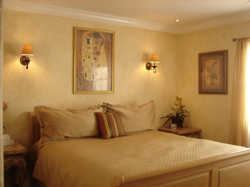 King bed in master bedroom in main house
