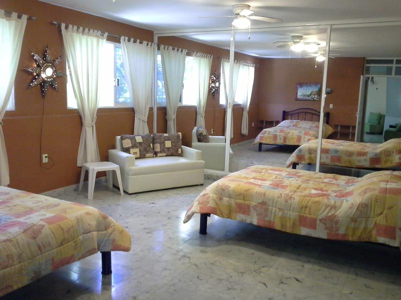 Huge bedroom...2 matrimonial beds (doubles) plus love seat...spaciousness.