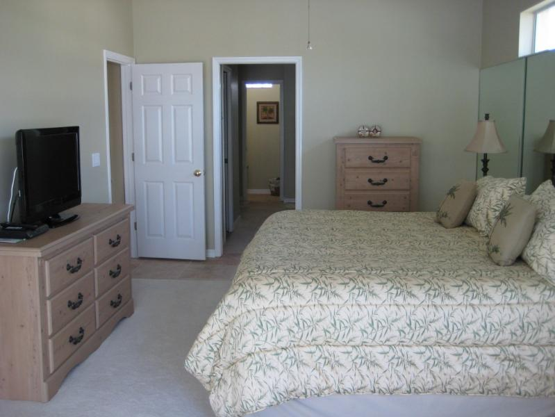 Master bedroom with king bed, two walk-in closets, cable TV, Blueray & ensuite