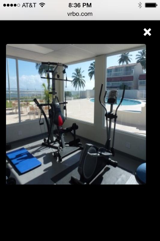 GYM...fully equipped...with views of pools and ocean.
