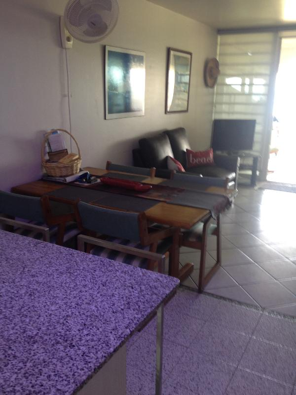 Dining table for six...another TV with separate cable box.