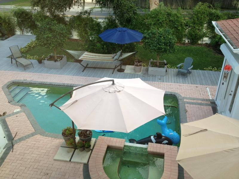 view on yard and pool from your suite window
