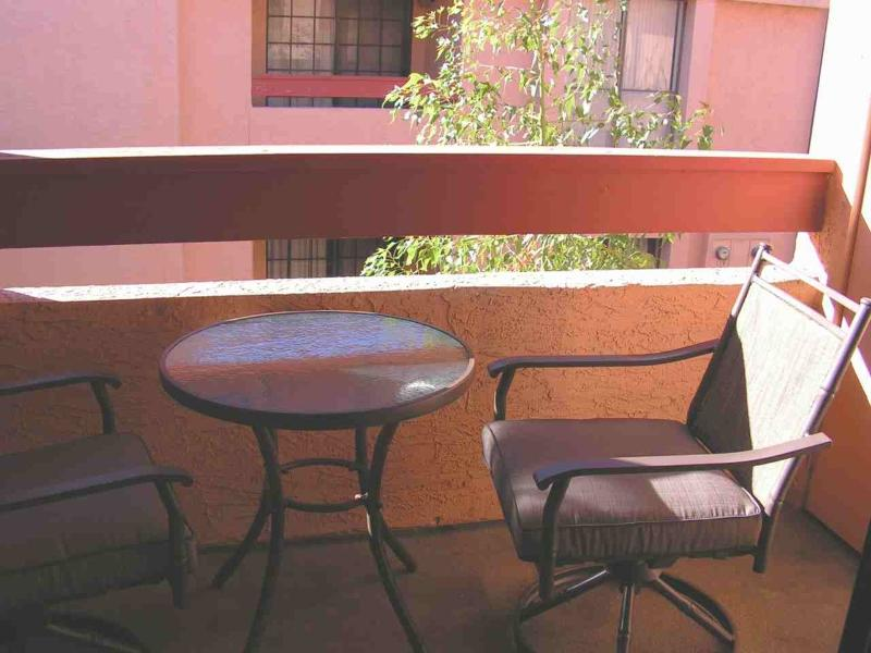 Lanai with table and chairs to enjoy the sun