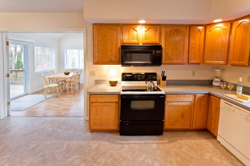 Fully Equipped Kitchen & Multi-Functional Sun Room With A Dining Capacity Of 16