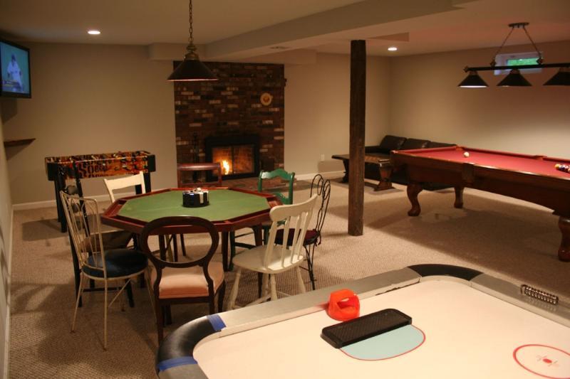 game room w/42' flatscreen, pool table, poker table, air hockey, foosball, bar