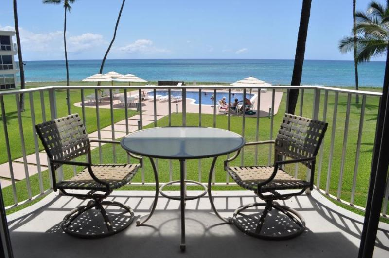 Lovely view from the apartment lanai, overlooking pool, courtyard and beach.