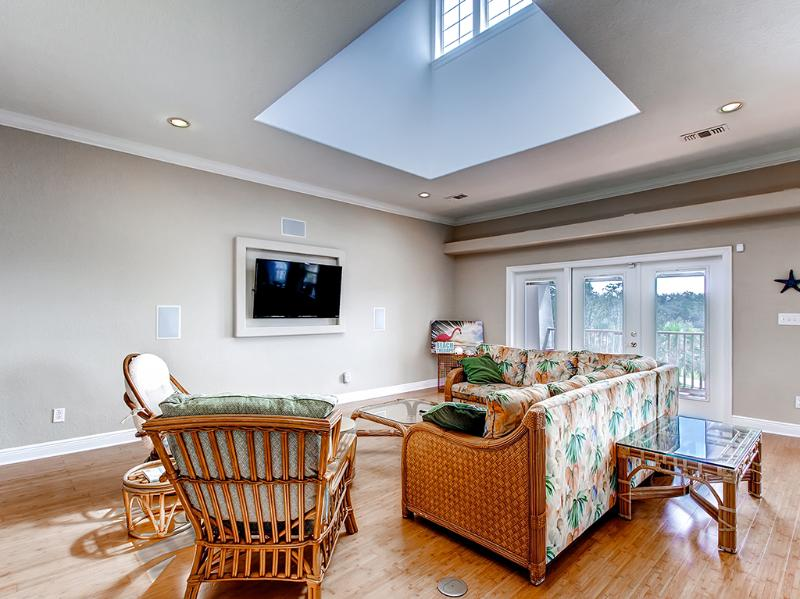 A skylight lets in tons of sunlight and a flat screen TV is available for your entertainment.