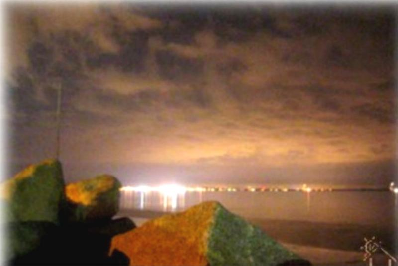 NIGHT LIGHTS FROM OLD ORCHARD BOUNCING OFF THE BAY