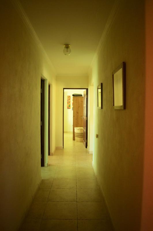 corridor between master bedroom and living room