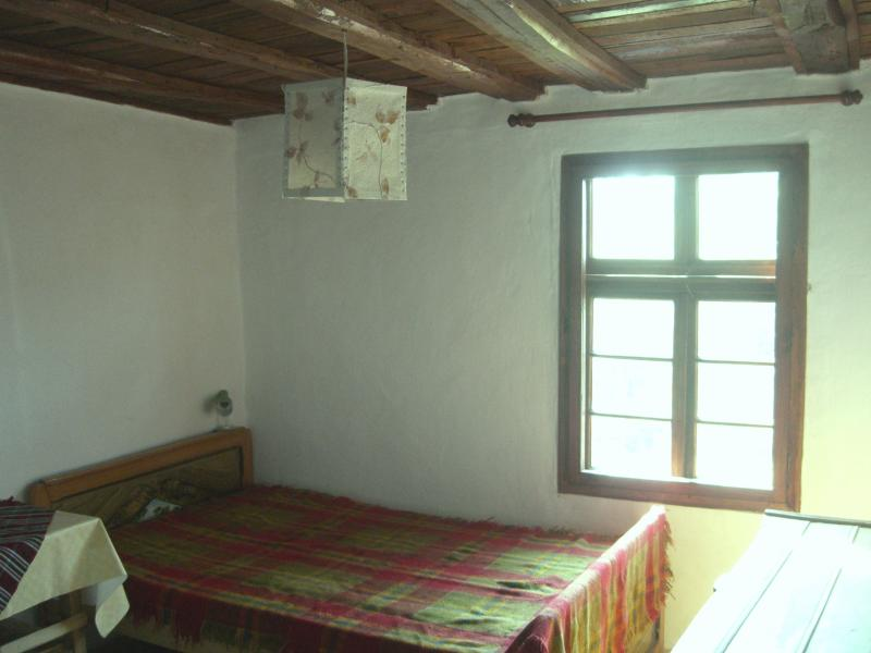 Second bedroom window and traditional double bed.
