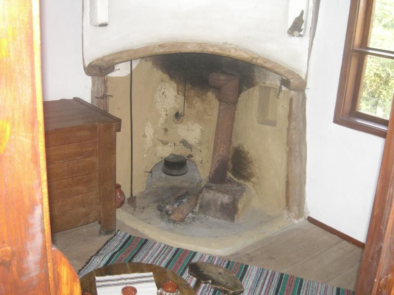 The old living room/third bedroom or dining room with open fire and lots of character. Also a fridge