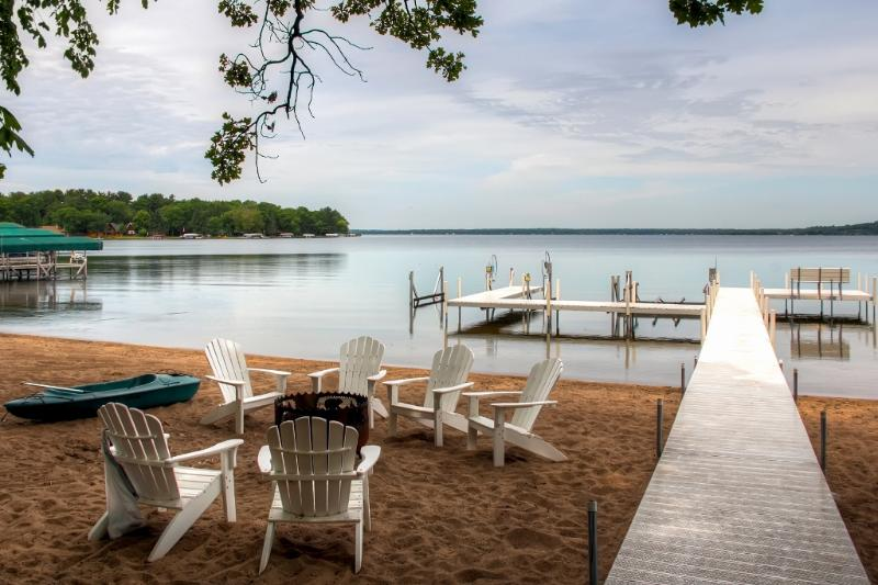 This cabin is nestled just steps from a sandy beach on Gull Lake!