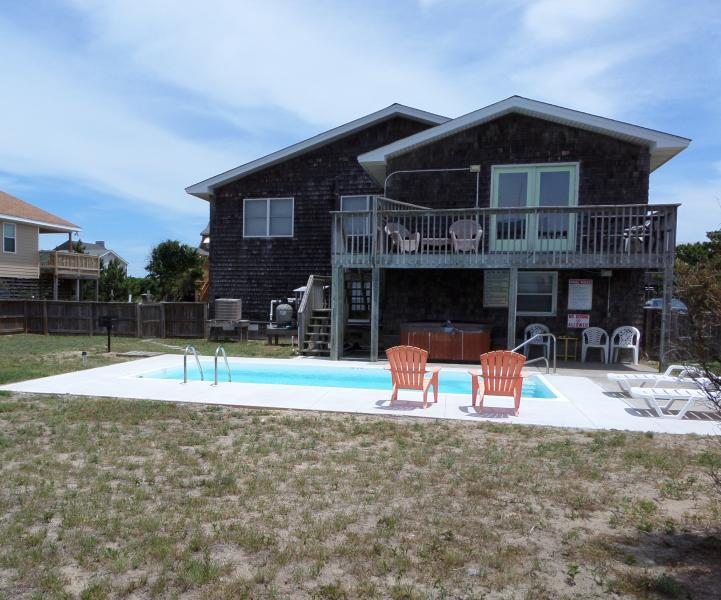fenced yard, private 10x20 pool(open mid Apr to mid Oct) and hot tub(year round)