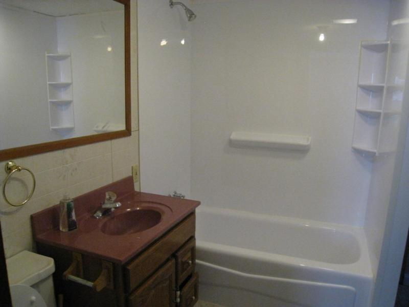 Bath with tub;  Other bath has a glass shower stall.