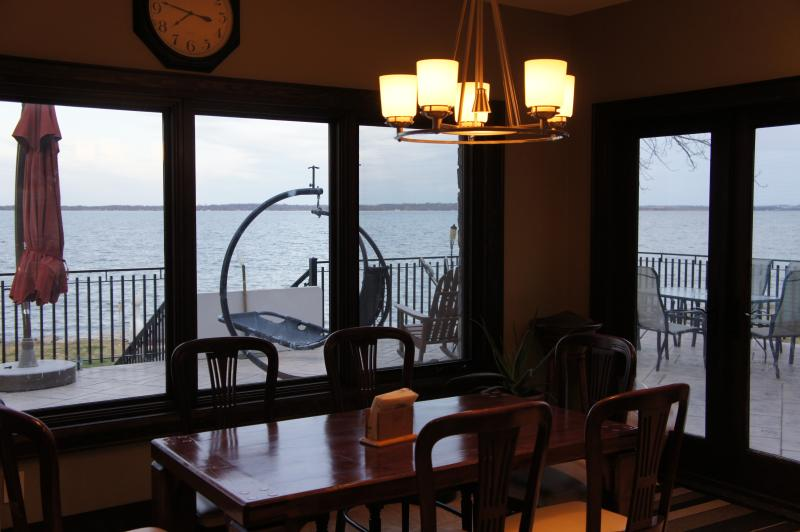 Dining room with view of patio/Lake Simcoe