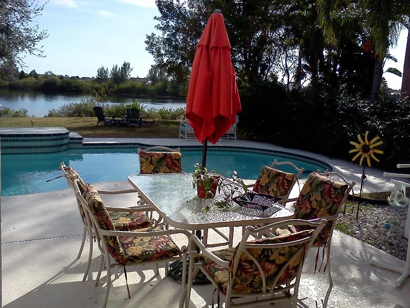 Relax by the waterfront pool in your private backyard.