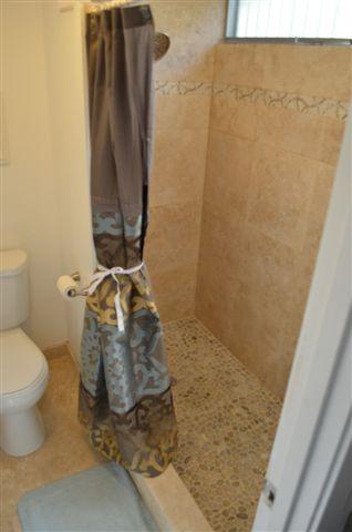 Floor to Ceiling Travertine Showers