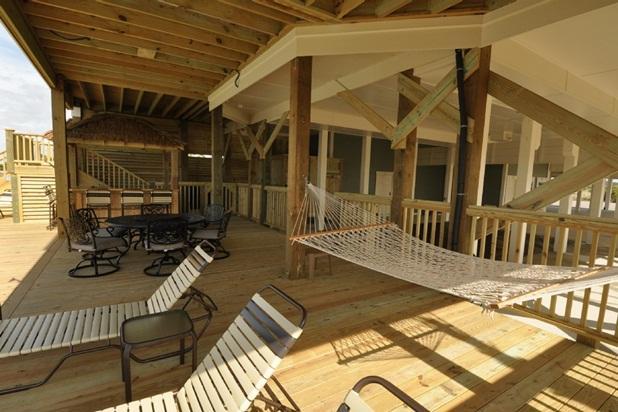 Under deck shade area Tiki Bar, round table, and hammock.
