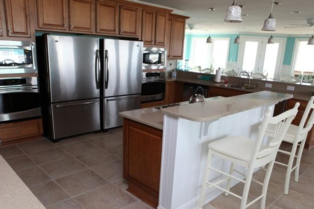 Fully stocked kitchen 3 refrigerators, 3 ovens, 2 microwaves and 10 burners