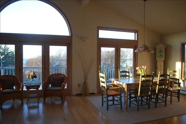 Dining area and deck beyond overlooking ocean