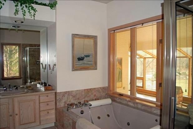 Master bath with dressing area, jacuzzi two person tub and separate shower