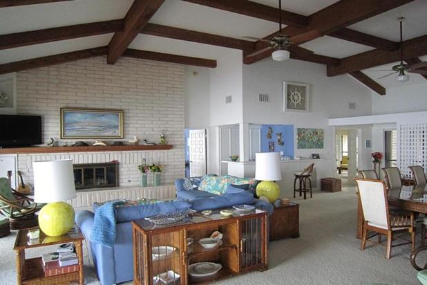 Spacious living room with formal dining area, wet bar, and views of the bay