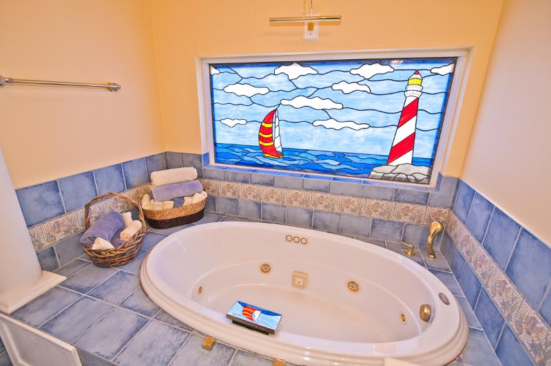 Jacuzzi Tub with Custom Made Stainless Glass Window!