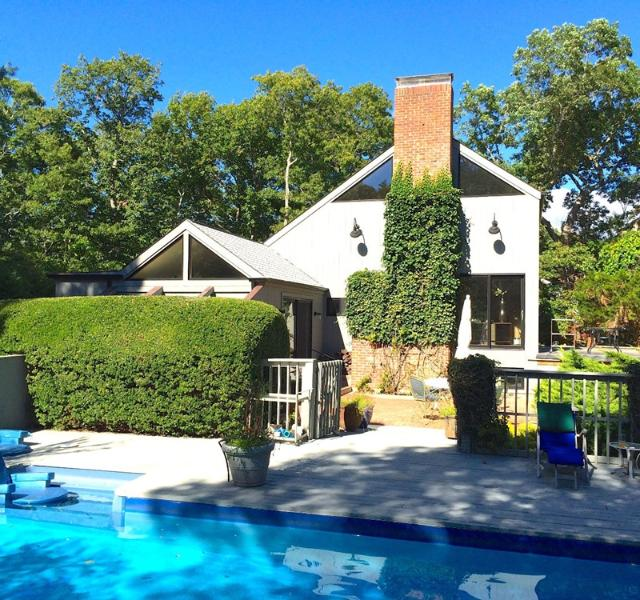 Brick Dining Patio (furnished). Viewed from gated pool and furnished pool deck. Completely private.
