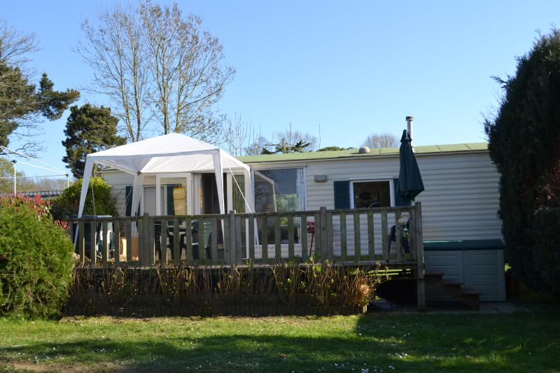 Our mobile home under the clear blue skies.