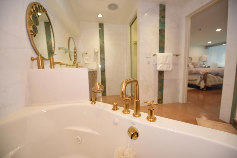 Luxury bathroom with separated toilet room. Vibrant® Moderne Brushed Gold faucet