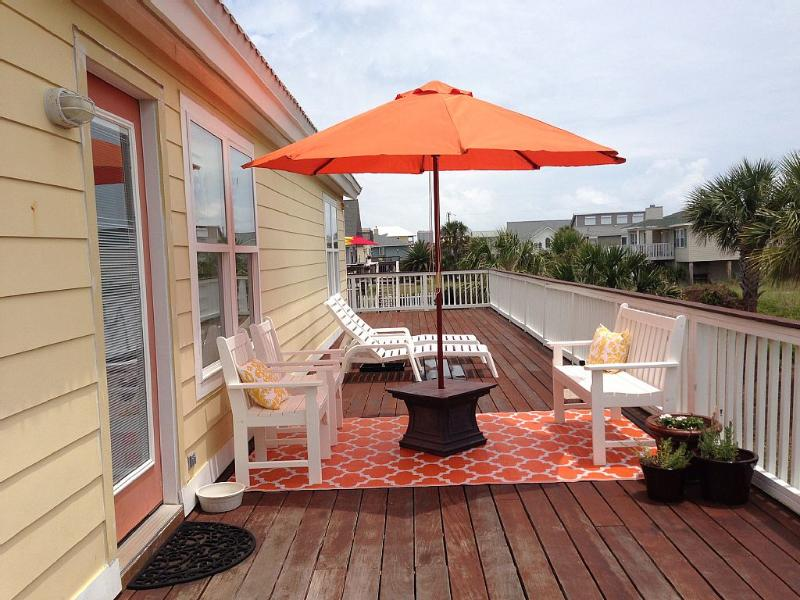 Soak up some sun and breath in the ocean air on the wrap around deck.
