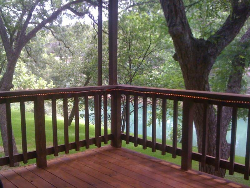 Large outdoor deck overlooks the river