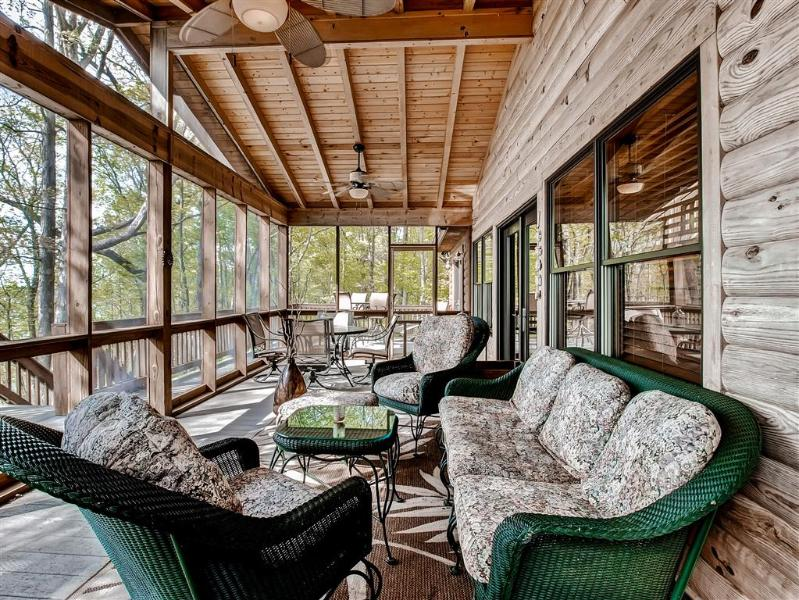 Plenty of comfortable seating for everyone on the large screened-in porch!