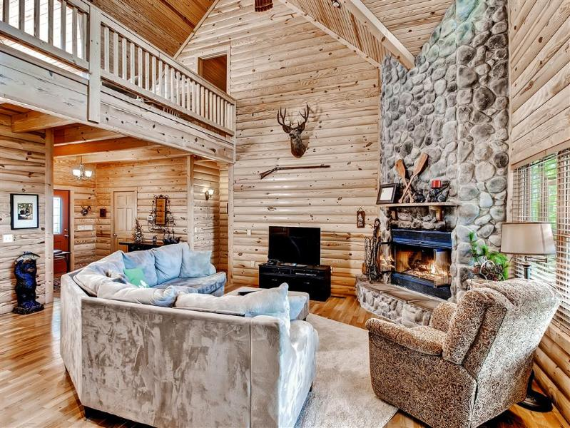Cozy up by the huge stone fireplace while admiring the spectacular views outside