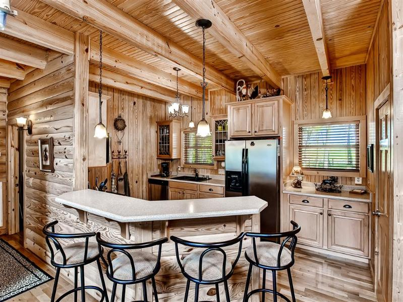 This charming kitchen comes fully equipped with all the necessary stainless steel appliances
