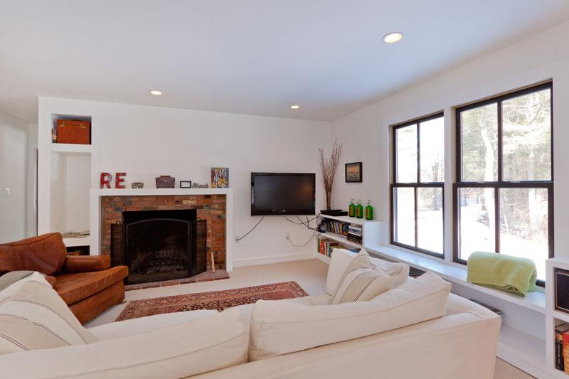 Gather in this cozy living room next to the warmth of the fireplace