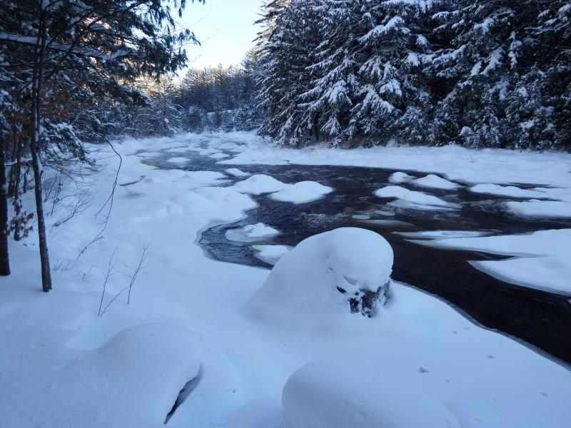 River after fresh snow at cabin site