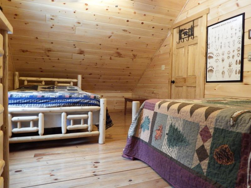 Upstairs bedroom two full beds