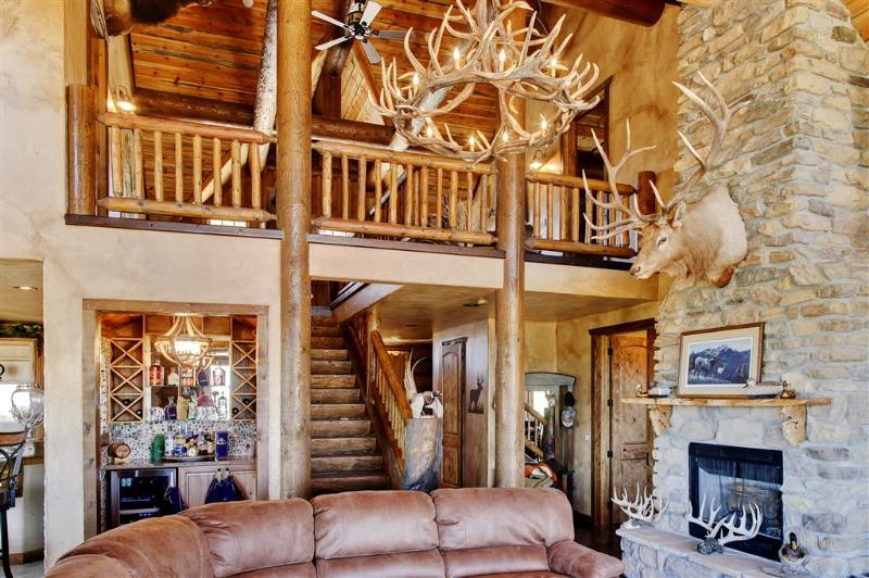 Cozy up by the large stone fireplace in the living room