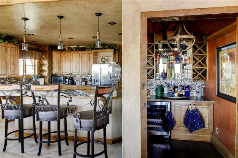 Enjoy a tasty  beverage from the wet bar during your downtime
