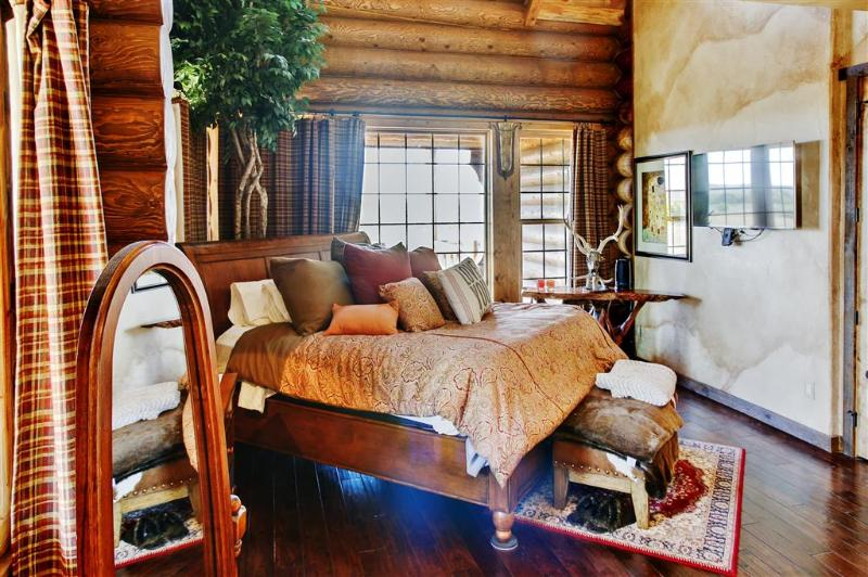 Get a restful night's sleep in this plush master bedroom
