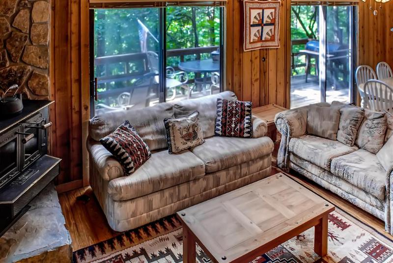 The cozy living area is the perfect spot to gather and socialize with your companions