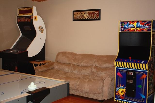Game room w/ 37' HDTV, Air hockey table, Golden Tee game & 48-Multi Arcade game